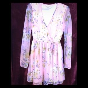 Romantic dress offering soft pastel floral print.